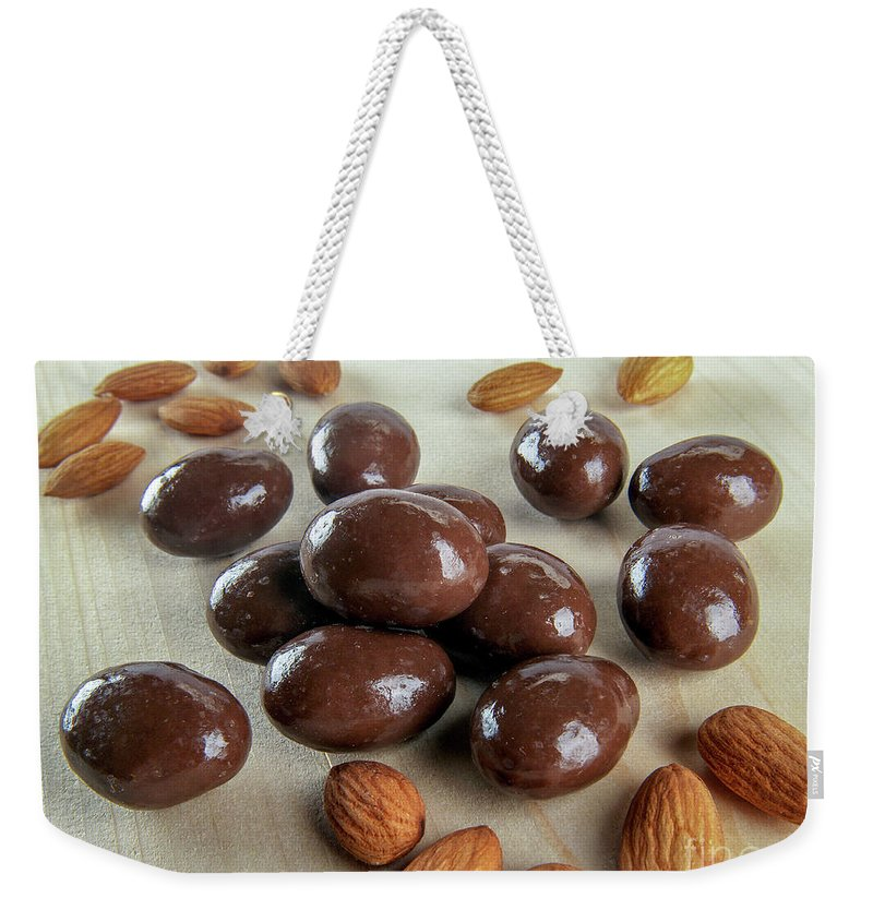 Carob Weekender Tote Bag featuring the photograph Carob Chocolate Coated Almonds A4 by Amit Strauss