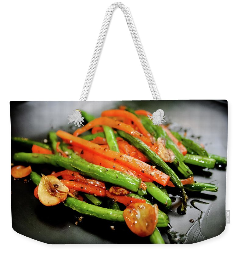 Garlic Weekender Tote Bag featuring the photograph Carrot And Green Beans Stir Fry by Iris Filson