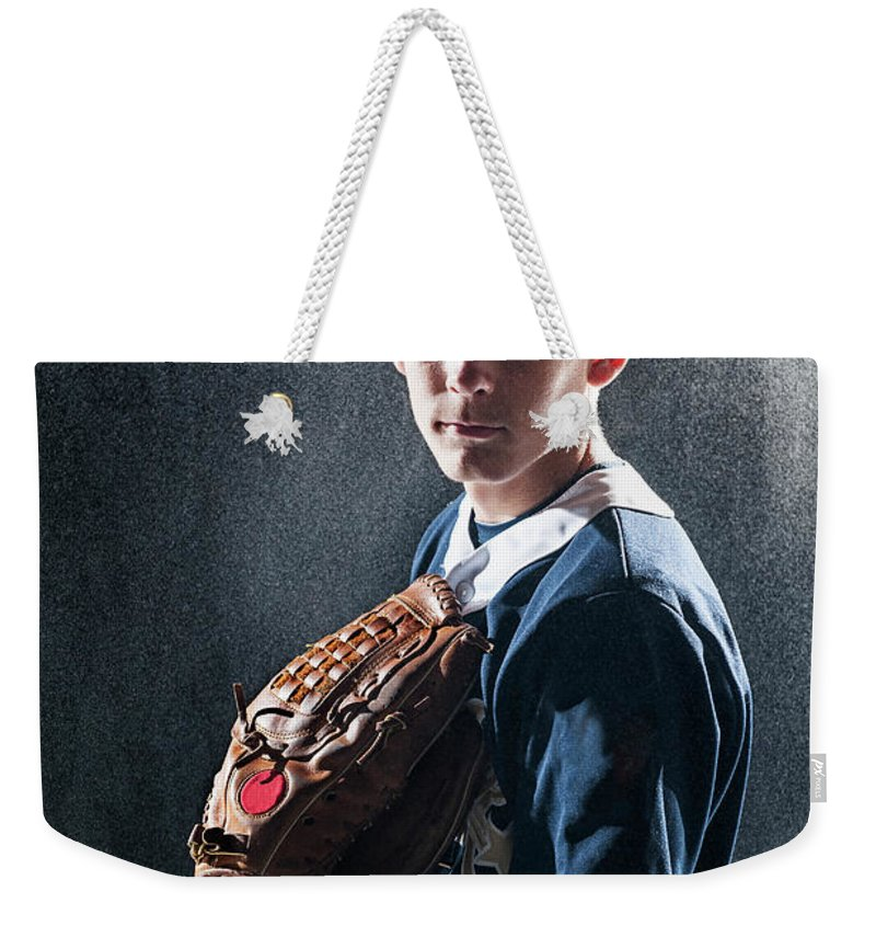 Baseball Cap Weekender Tote Bag featuring the photograph Caucasian Baseball Player Standing by Erik Isakson