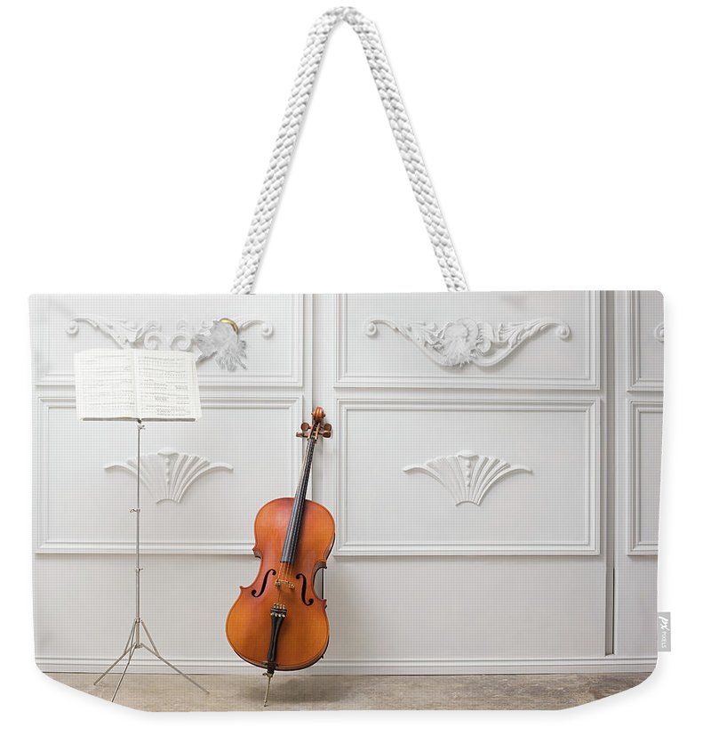 Sheet Music Weekender Tote Bag featuring the photograph Cello And Music Stand by Image Source