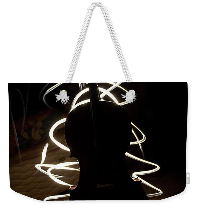 Music Weekender Tote Bag featuring the photograph Cello By Torchlight by Photo By Anthony Thomas