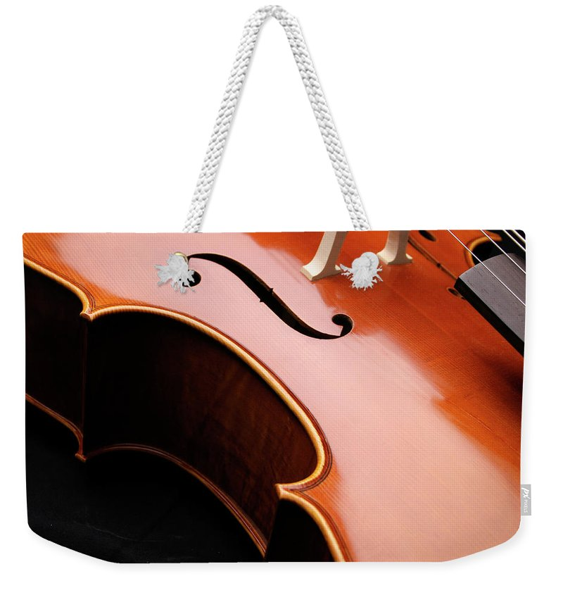 Curve Weekender Tote Bag featuring the photograph Cello Closeup by Vtwinpixel