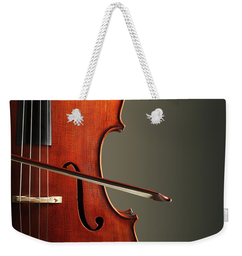 Music Weekender Tote Bag featuring the photograph Cello by Dny59