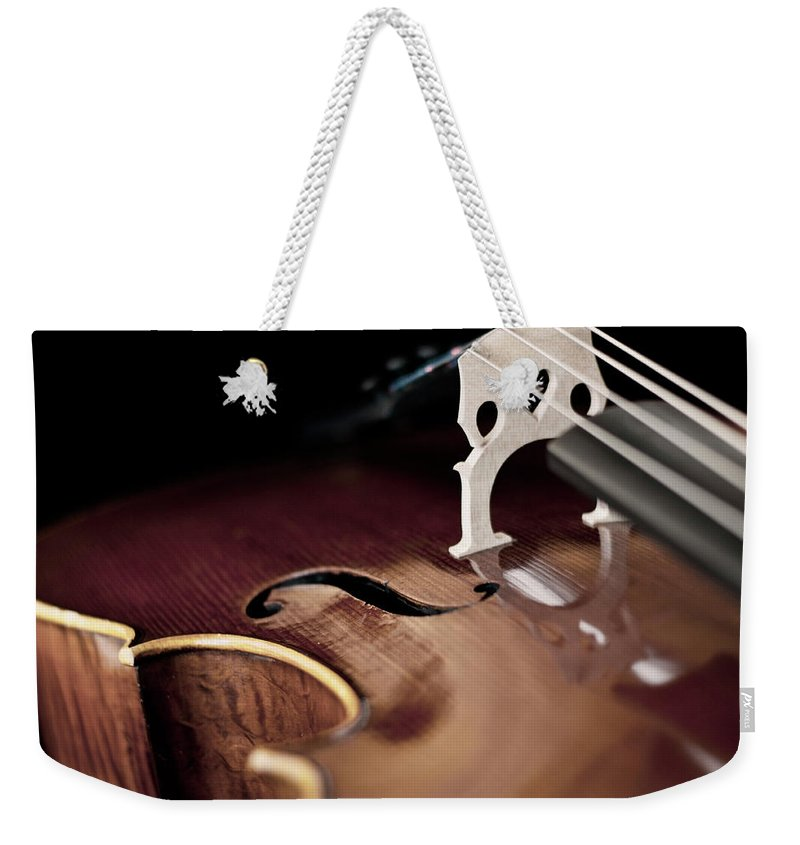 Music Weekender Tote Bag featuring the photograph Cello Reflections by Www.cfwphotography.com