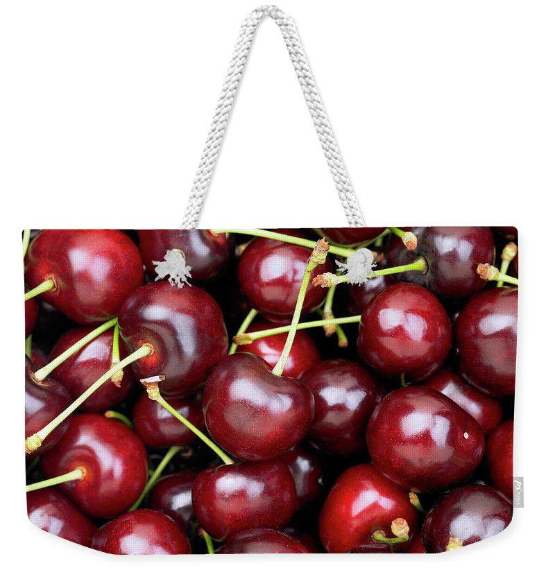 Cherry Weekender Tote Bag featuring the photograph Cherries by Maria Toutoudaki