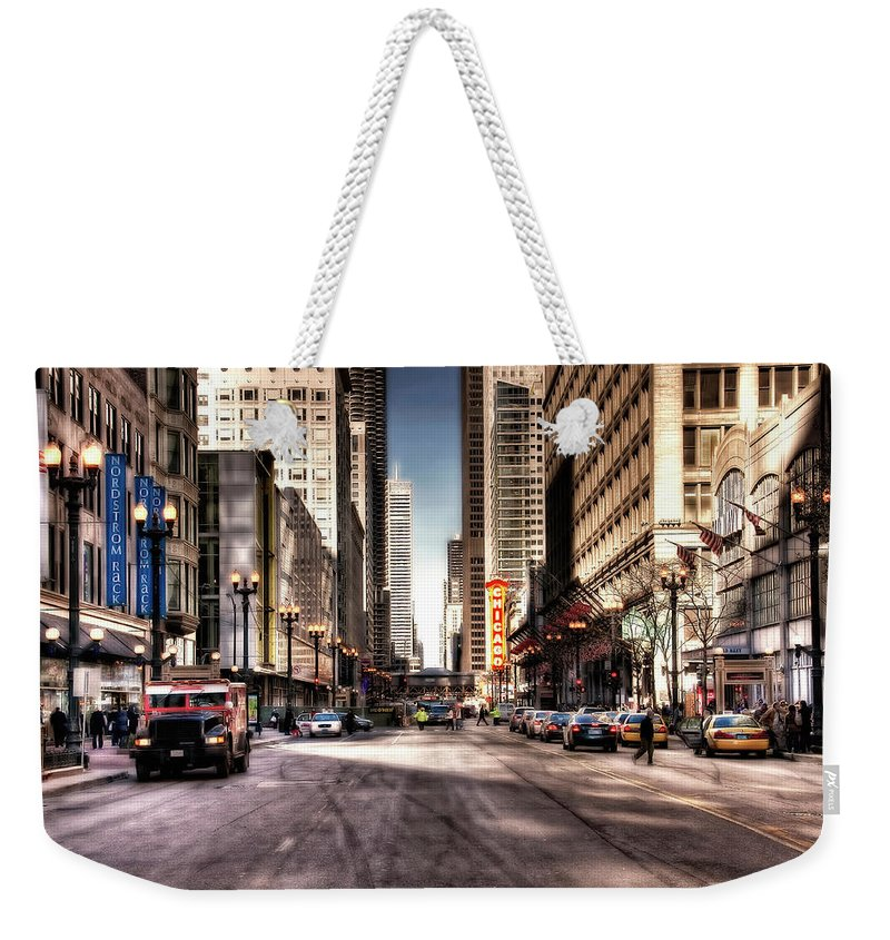 Downtown District Weekender Tote Bag featuring the photograph Chicago City Center At State Street by Paul Biris