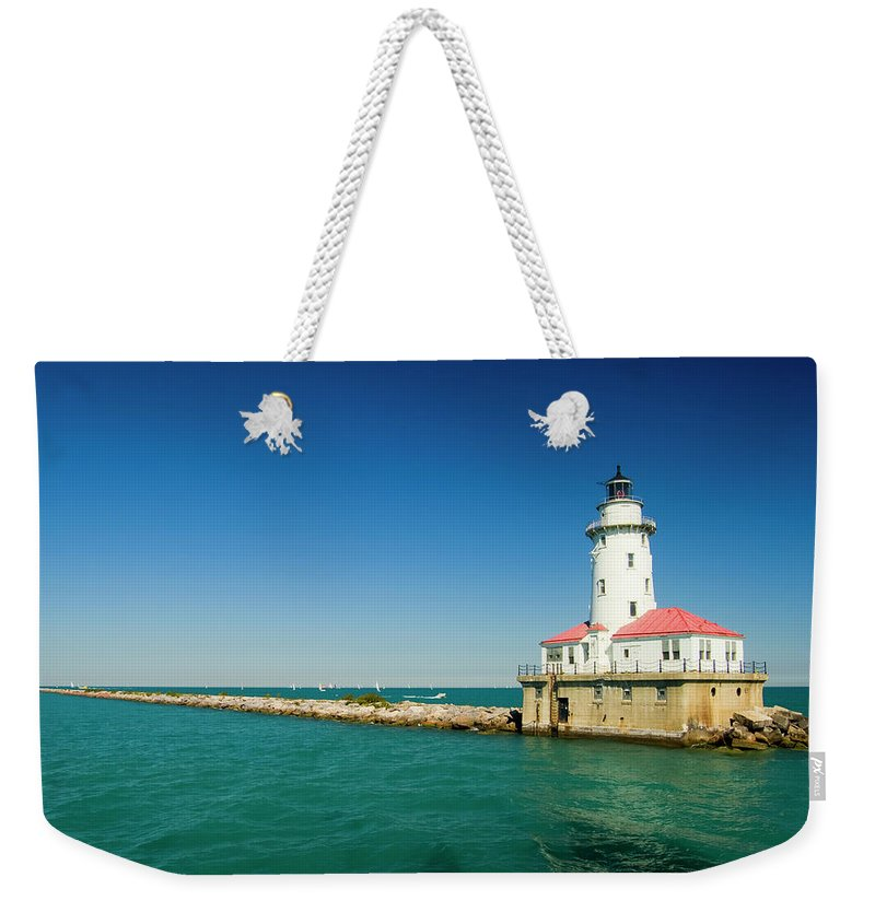 Lake Michigan Weekender Tote Bag featuring the photograph Chicago Harbor Lighthouse by Chrisp0