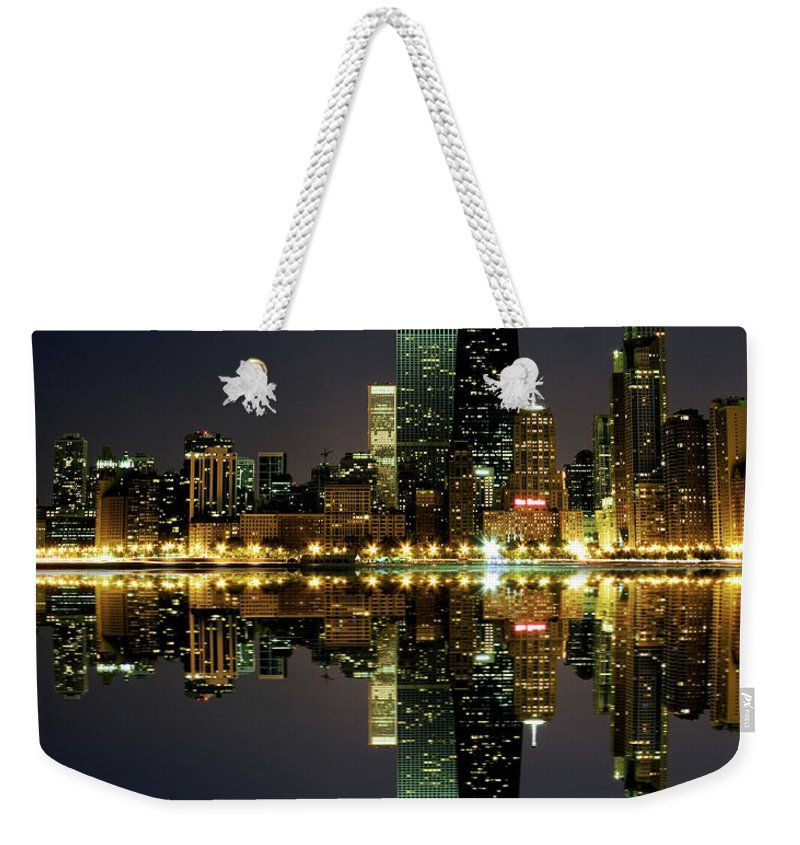 Lake Michigan Weekender Tote Bag featuring the photograph Chicago Skyline Reflected On Lake by Pawel.gaul
