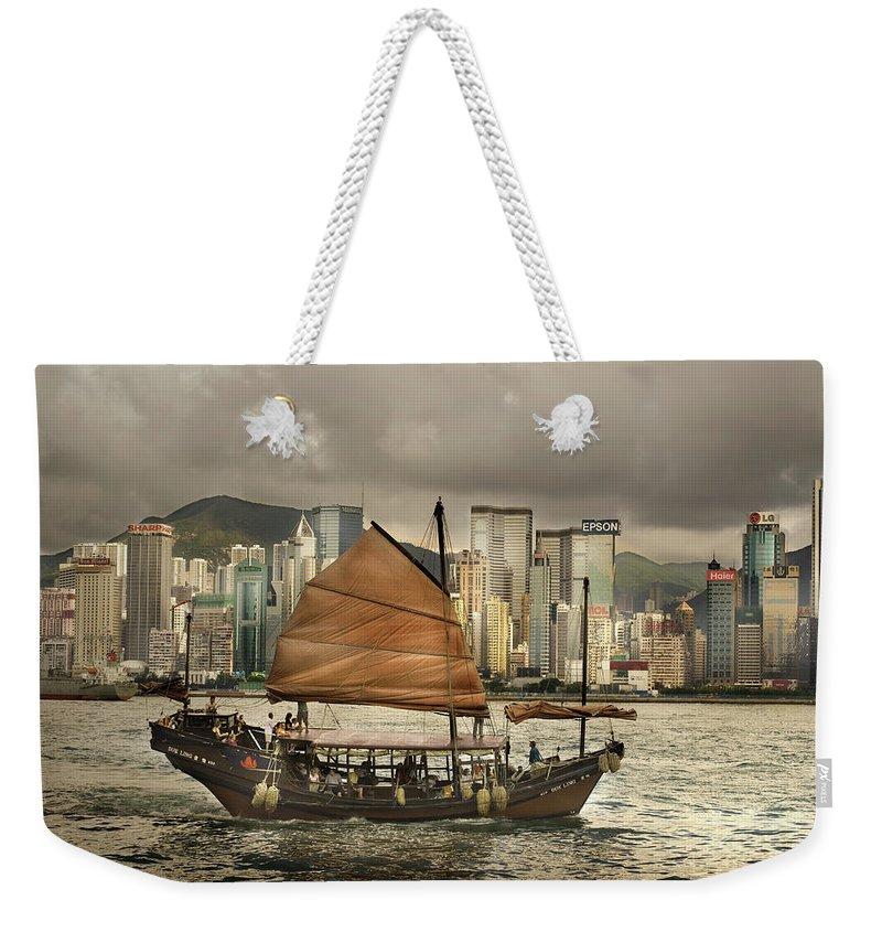 Sailboat Weekender Tote Bag featuring the photograph China, Hong Kong, Junk Boat In Bay by Maremagnum