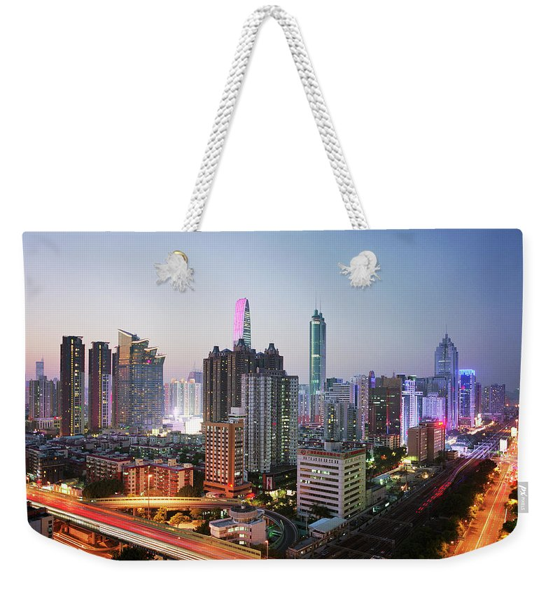 Corporate Business Weekender Tote Bag featuring the photograph China, Shenzen Skyline At Dusk by Martin Puddy