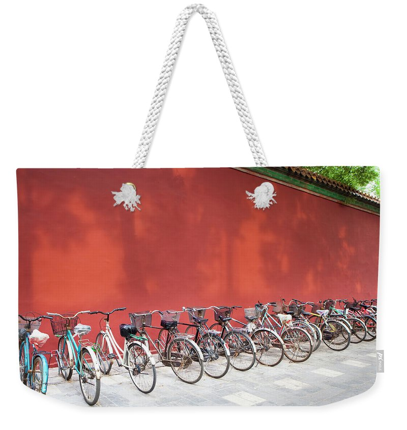 Shadow Weekender Tote Bag featuring the photograph Chinese Bikes by Sam Diephuis
