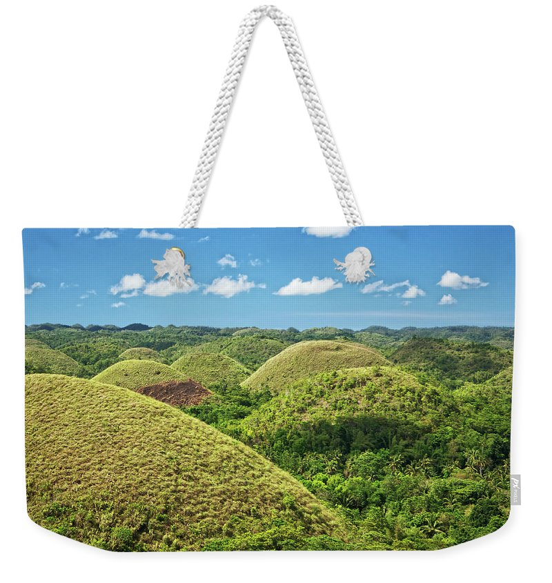 Scenics Weekender Tote Bag featuring the photograph Chocolate Hills In Bohol by Photography By Jeremy Villasis. Philippines.