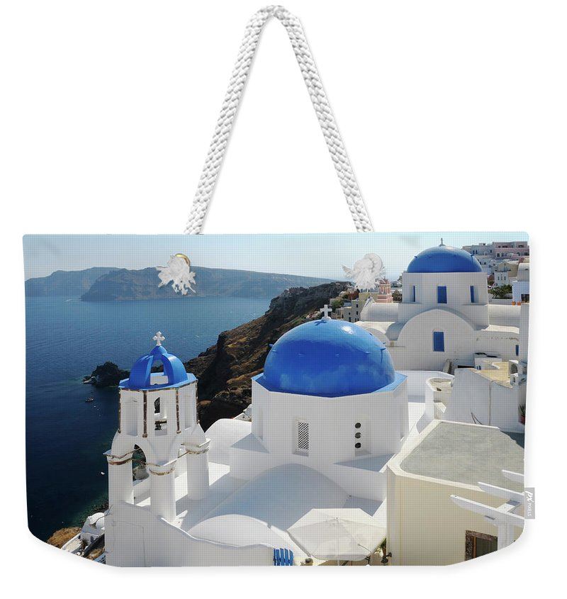 Greek Culture Weekender Tote Bag featuring the photograph Churches In Oia, Santorini, Greece by Tunart