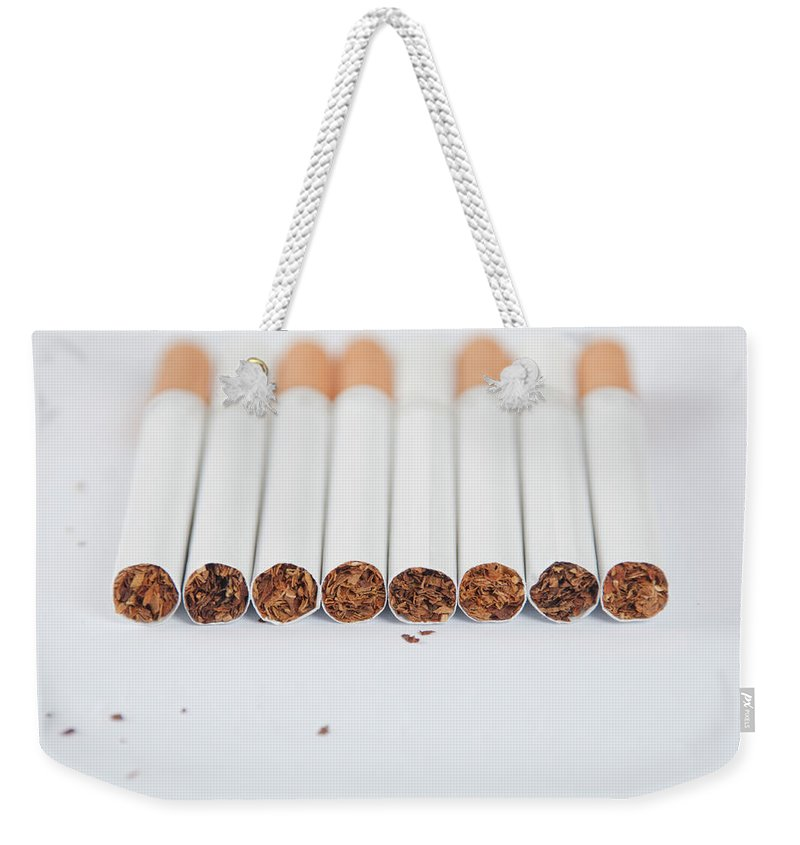 White Background Weekender Tote Bag featuring the photograph Cigarette by Shui Ta Shan