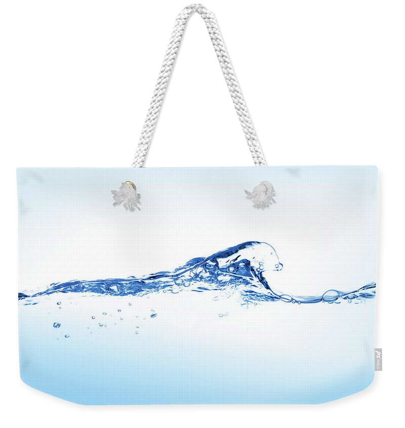 Purity Weekender Tote Bag featuring the photograph Clear Blue Water Splashing, Ripples And by Pixedeli