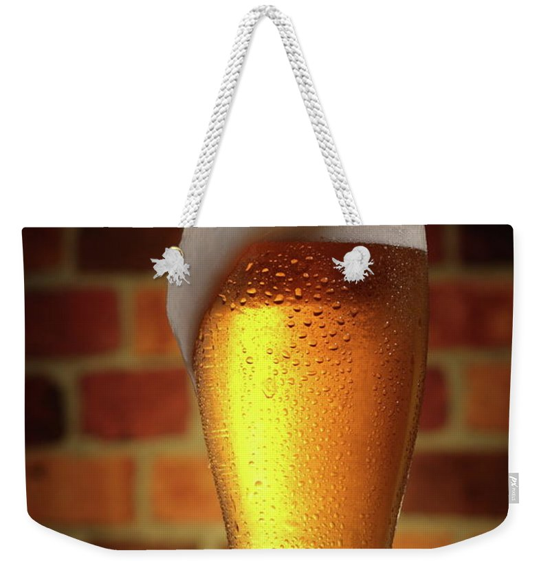 Orange Color Weekender Tote Bag featuring the photograph Clear Cold Bear With Foam Overflow by Eltoddo