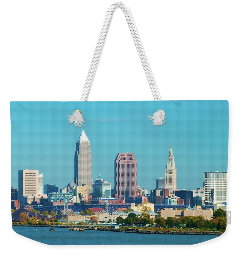 Downtown District Weekender Tote Bag featuring the photograph Cleveland Skyline And Lake Erie by Davel5957