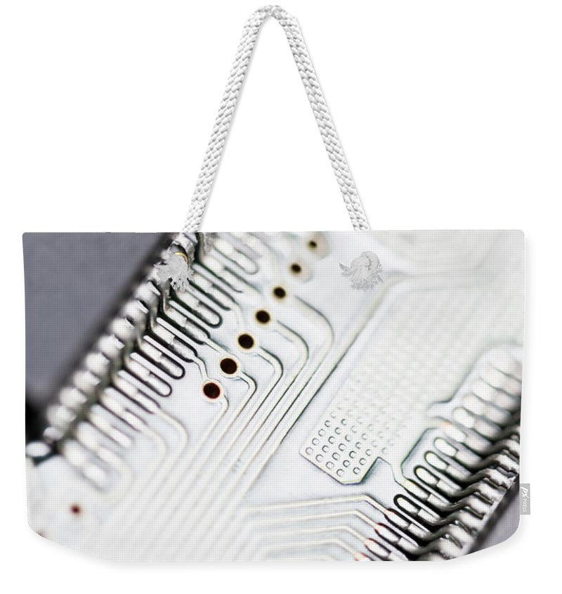 Electrical Component Weekender Tote Bag featuring the photograph Close-up Of A Circuit Board by Nicholas Rigg