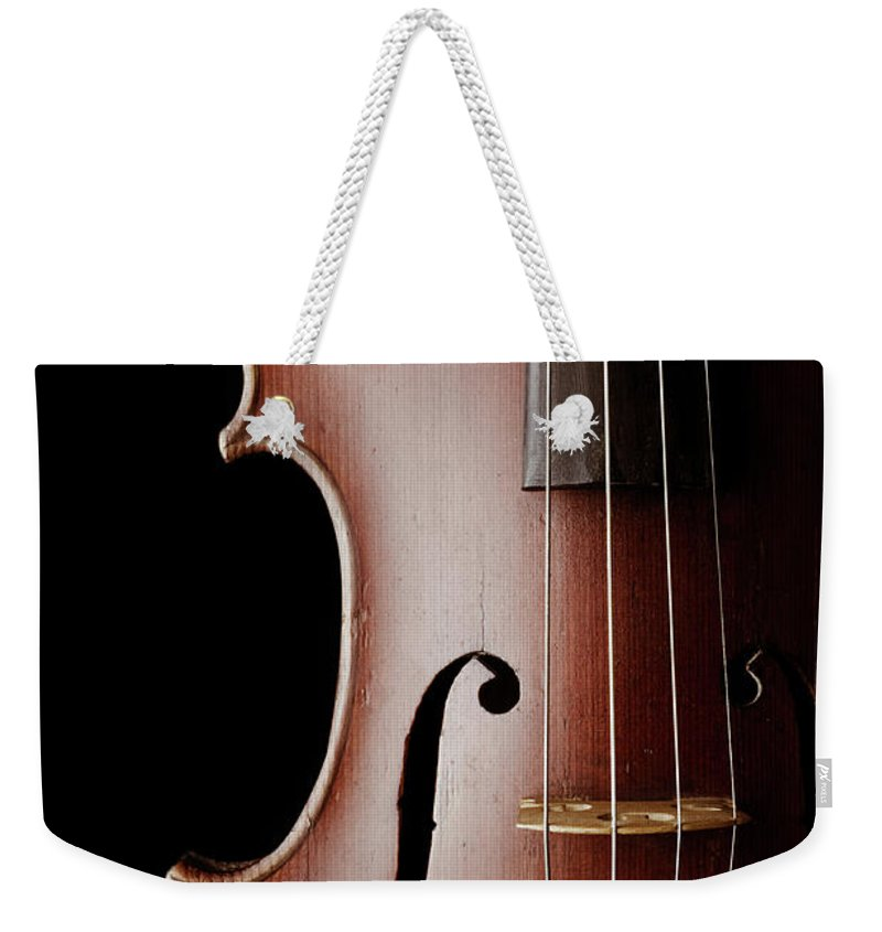 Education Weekender Tote Bag featuring the photograph Close-up Of A Classic Violin Isolated by Nmaximova