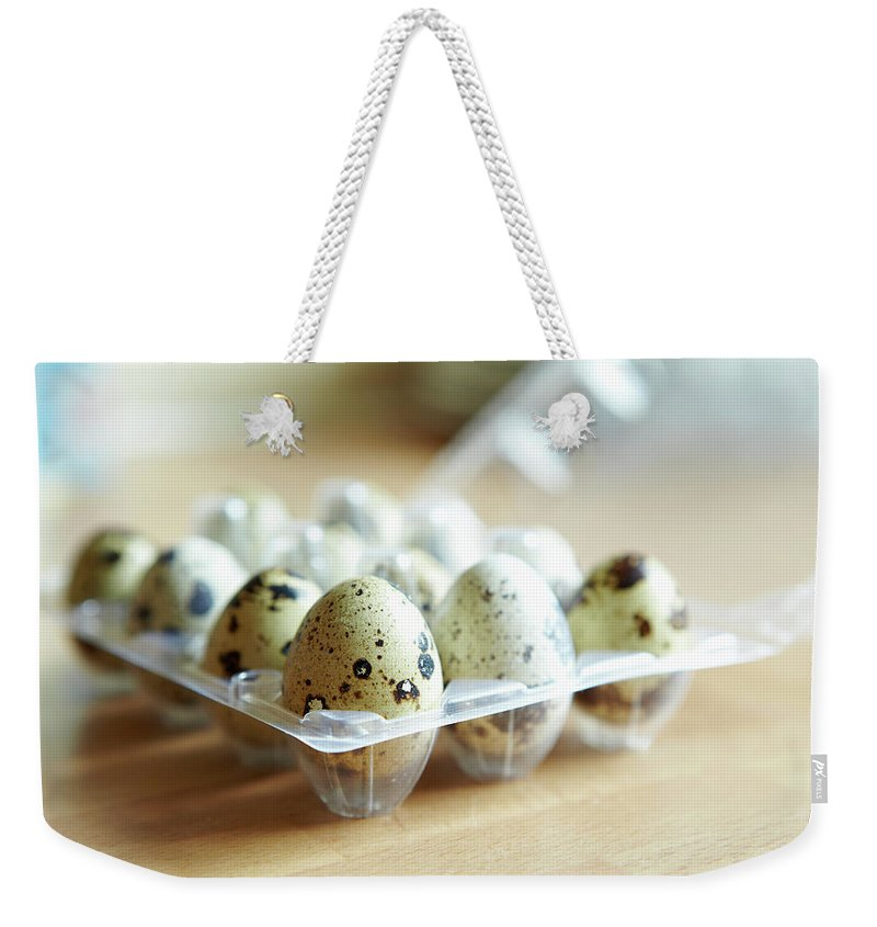 Large Group Of Objects Weekender Tote Bag featuring the photograph Close Up Of Carton Of Quail Eggs by Debby Lewis-harrison