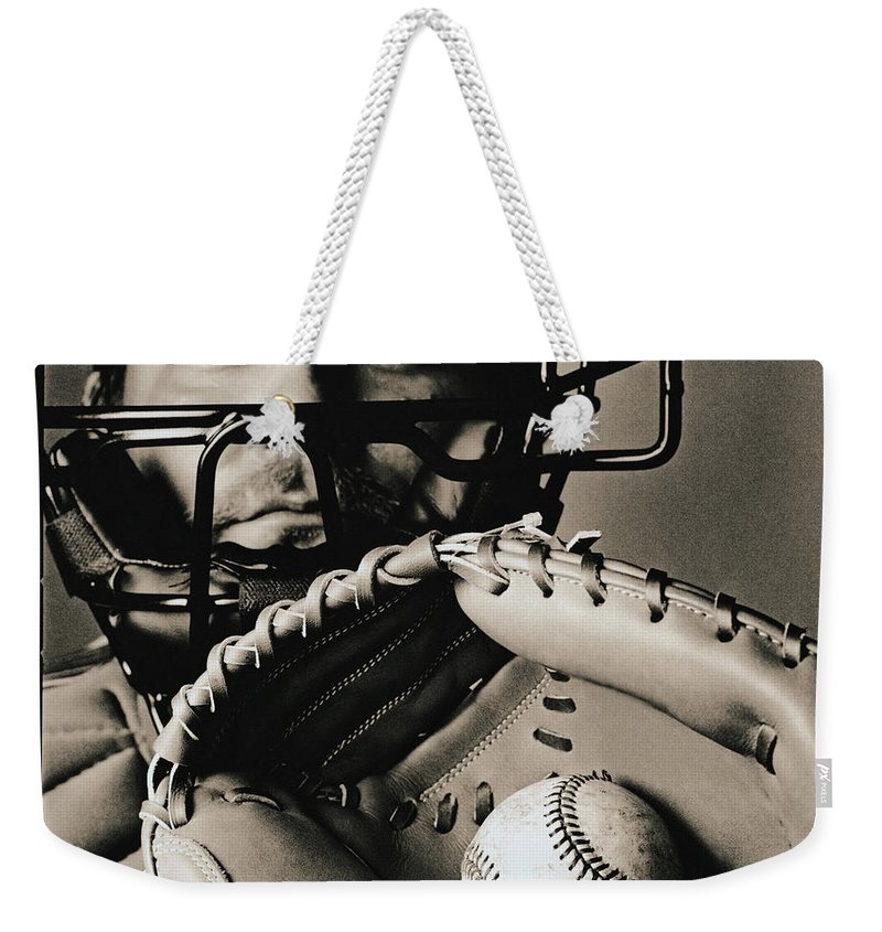 Baseball Catcher Weekender Tote Bag featuring the photograph Close-up Of Catcher by Anthony Saint James