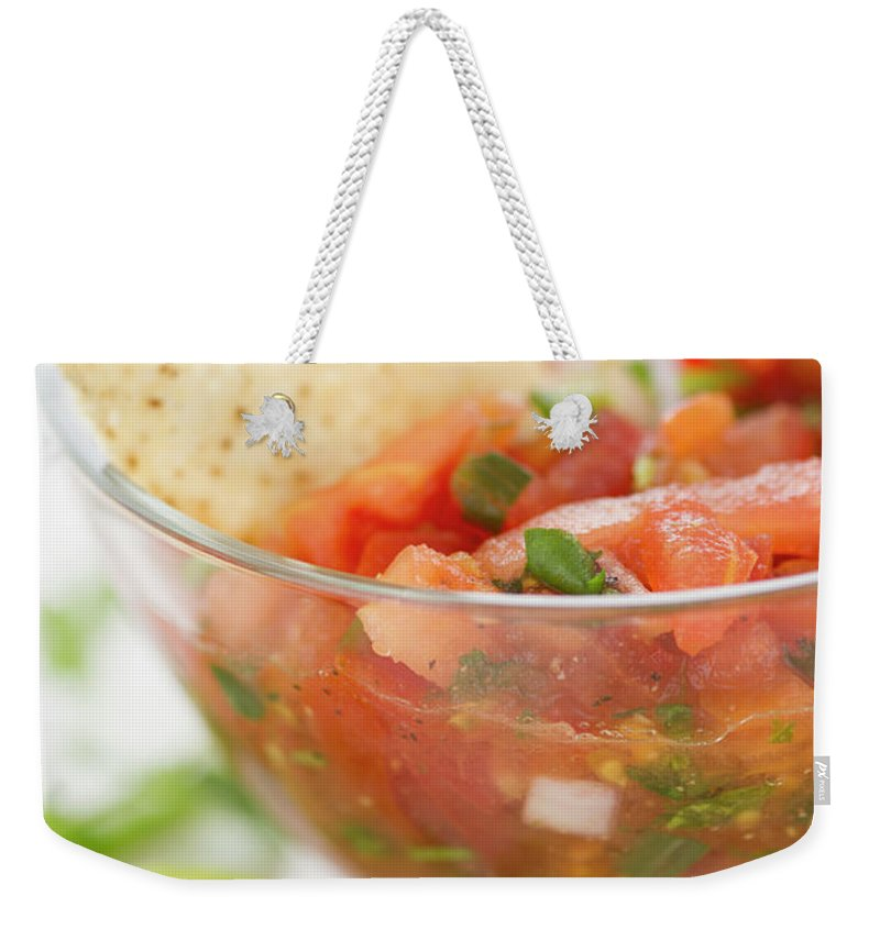 Close-up Weekender Tote Bag featuring the photograph Close Up Of Salad In Bowl, Studio Shot by Jamie Grill
