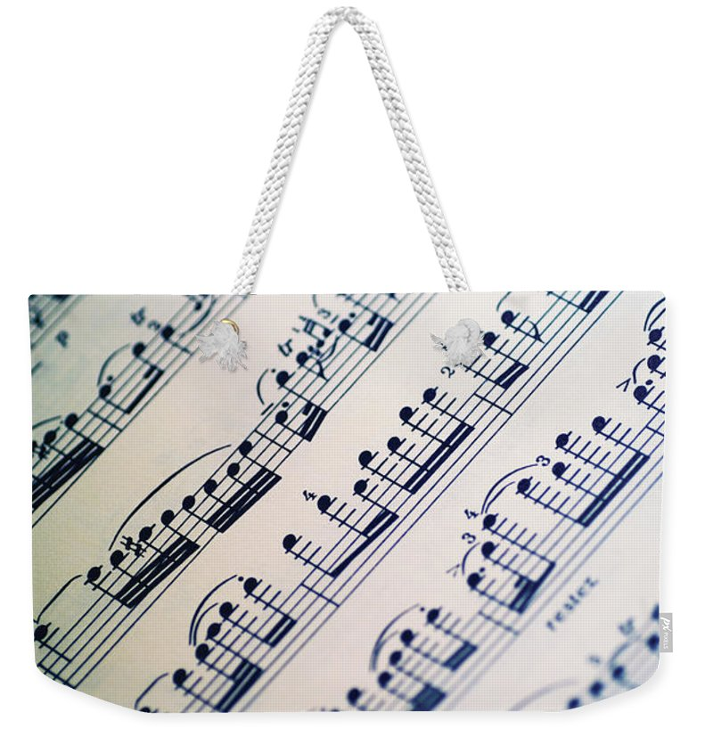 Sheet Music Weekender Tote Bag featuring the photograph Close-up Of Sheet Music by Medioimages/photodisc