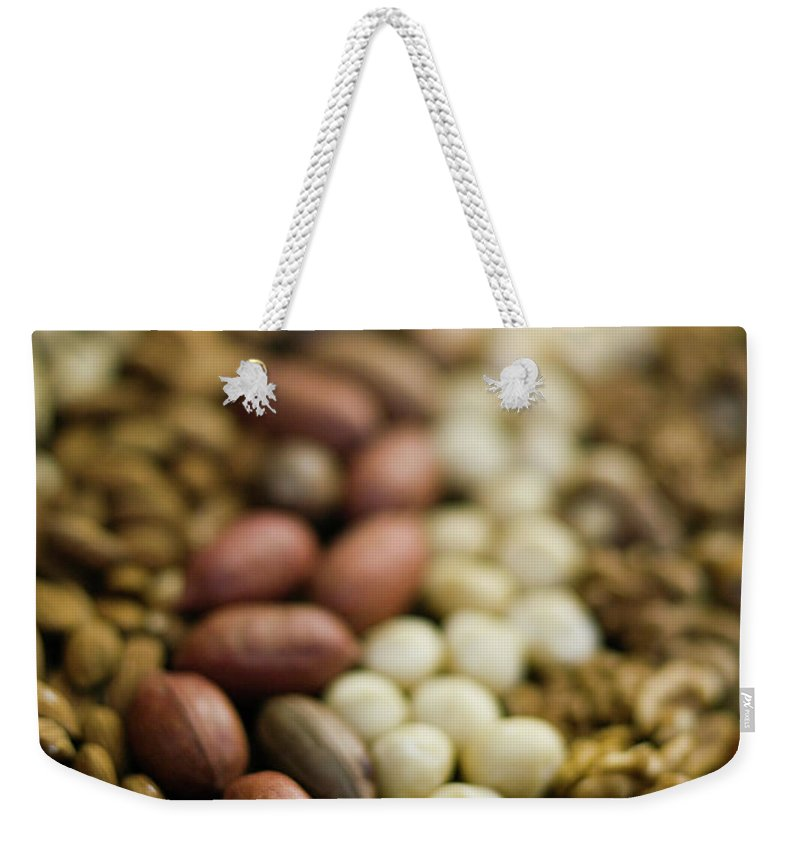 Nut Weekender Tote Bag featuring the photograph Close Up Of Variety Of Nuts by Johner Images