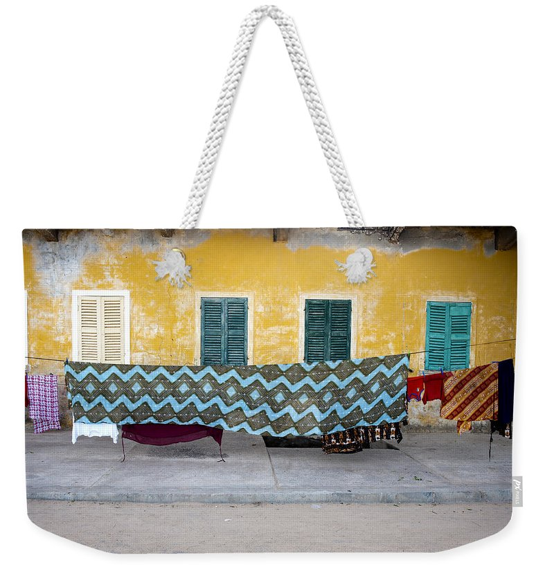 Hanging Weekender Tote Bag featuring the photograph Clothes Hanging by Roripalazzo.com