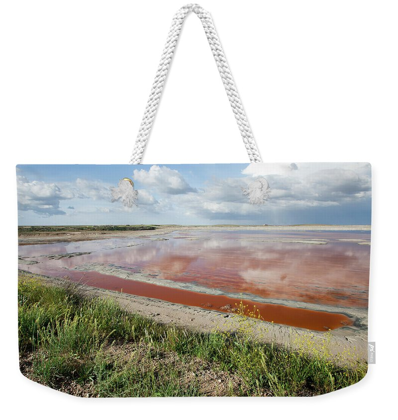Problems Weekender Tote Bag featuring the photograph Clouds Reflection On Red Water by 1001slide
