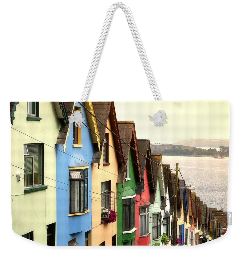 Electricity Pylon Weekender Tote Bag featuring the photograph Cobh, Cork by Photo By Natale Carioni