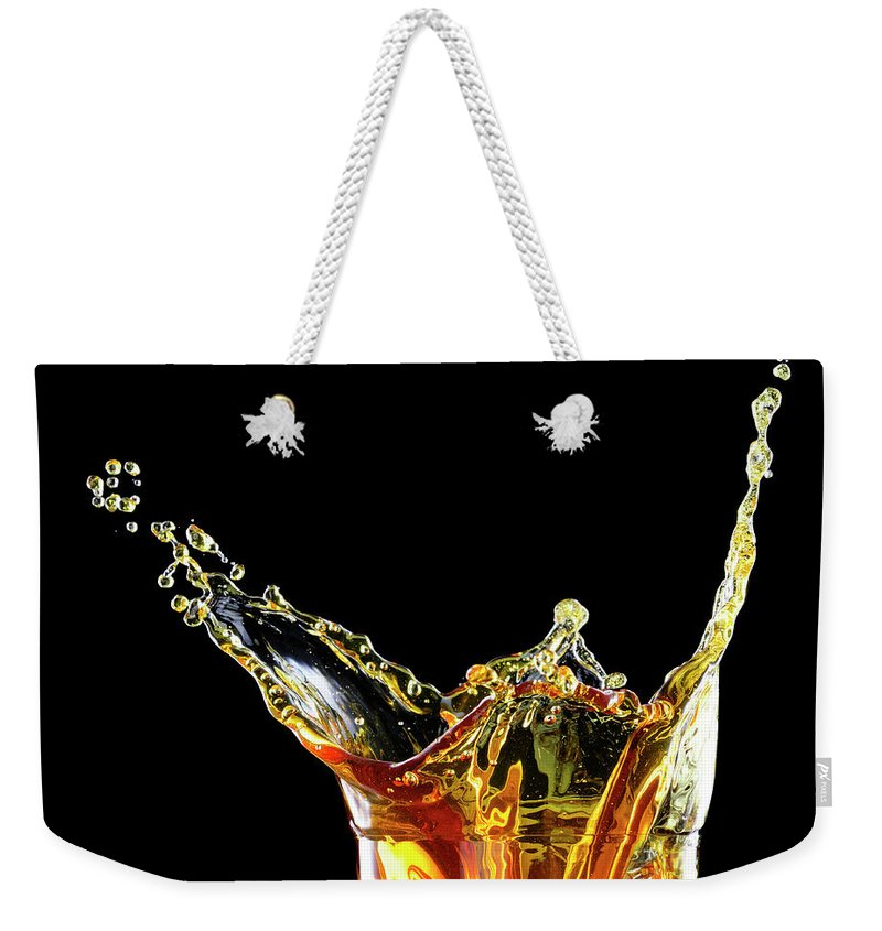 Alcohol Weekender Tote Bag featuring the photograph Cocktail With Big Splash In A Tumbler by Chris Stein
