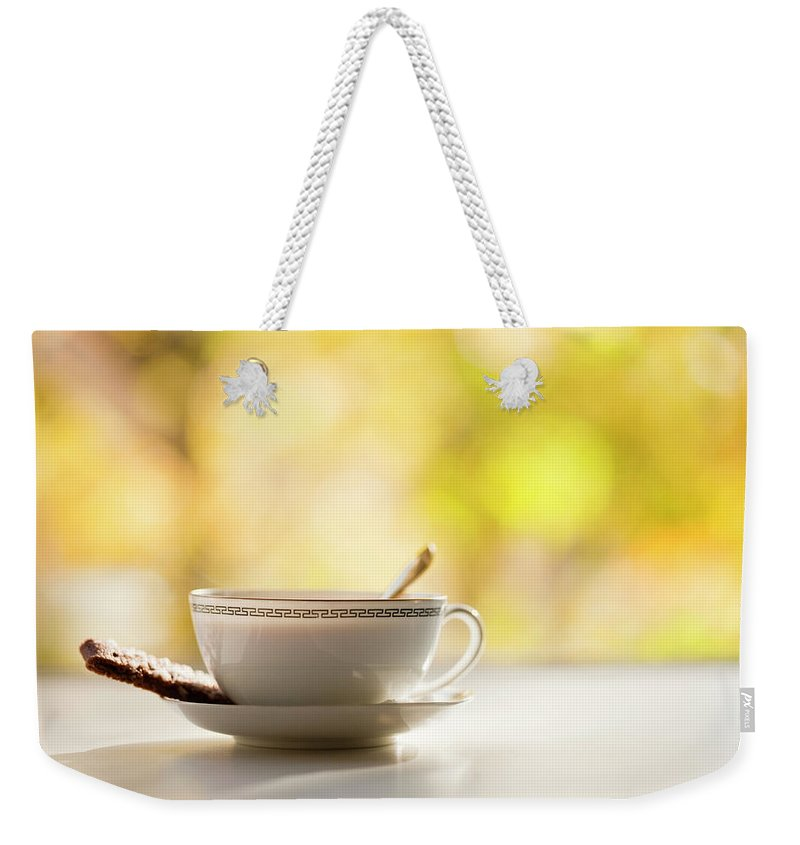 Food And Drink Weekender Tote Bag featuring the photograph Coffee Cup With Cookie, Still Life by Johner Images