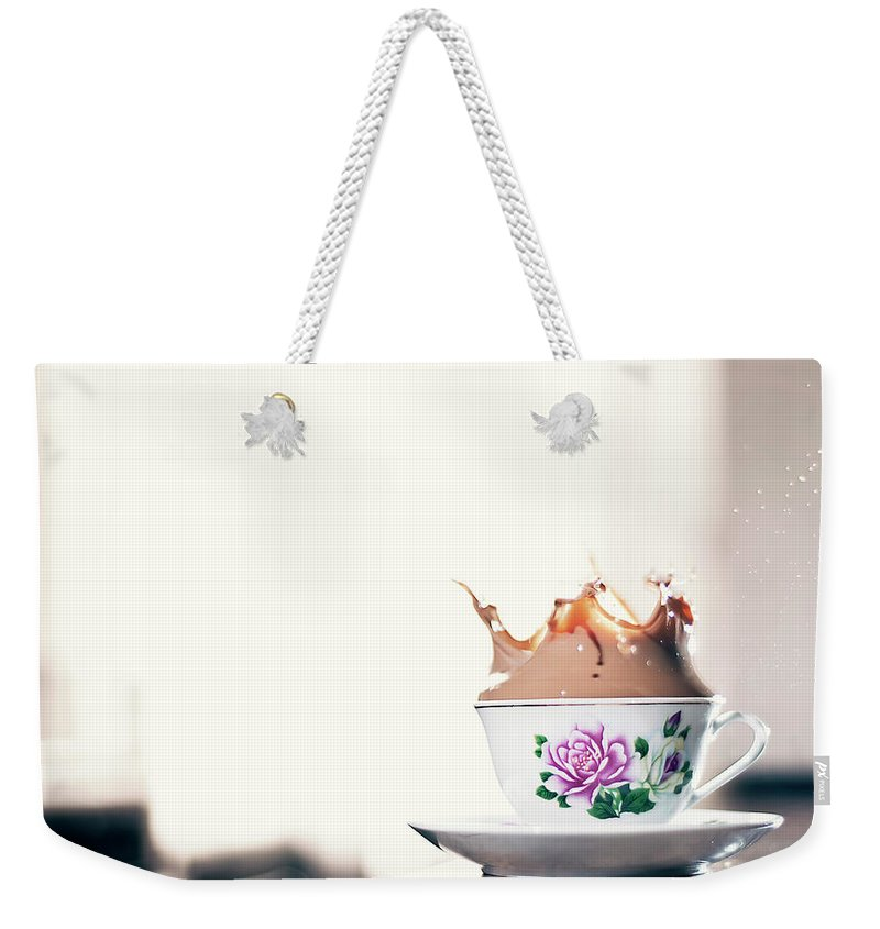 Motion Weekender Tote Bag featuring the photograph Coffee Splash In Kitchen by Photographs By Vitaliy Piltser