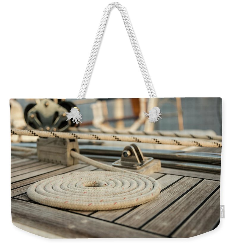 Sailboat Weekender Tote Bag featuring the photograph Coiled Line, Rope, On Teak Deck Of 62 by Gary S Chapman