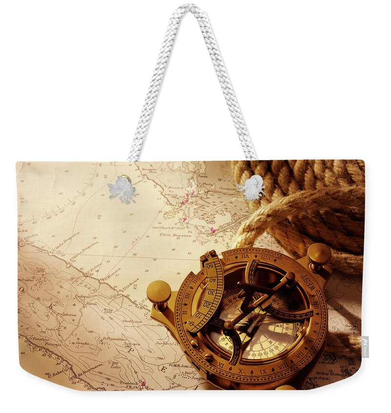 Rope Weekender Tote Bag featuring the photograph Coiled Rope And Nautical Chart With A by Wragg