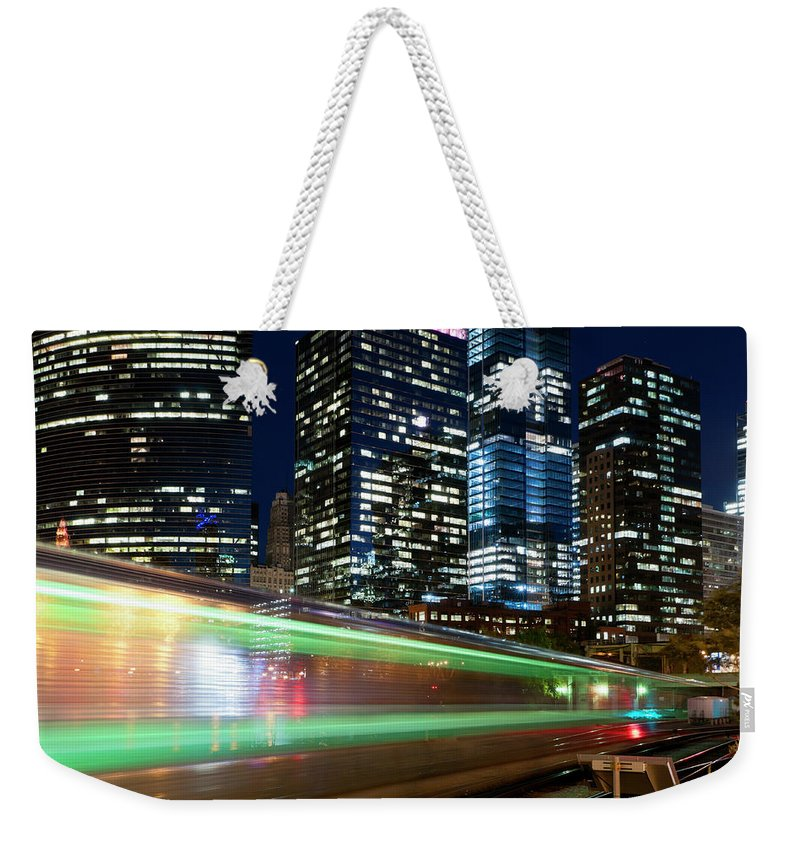 Passenger Train Weekender Tote Bag featuring the photograph Commuter Train In Downtown Chicago by Chrisp0