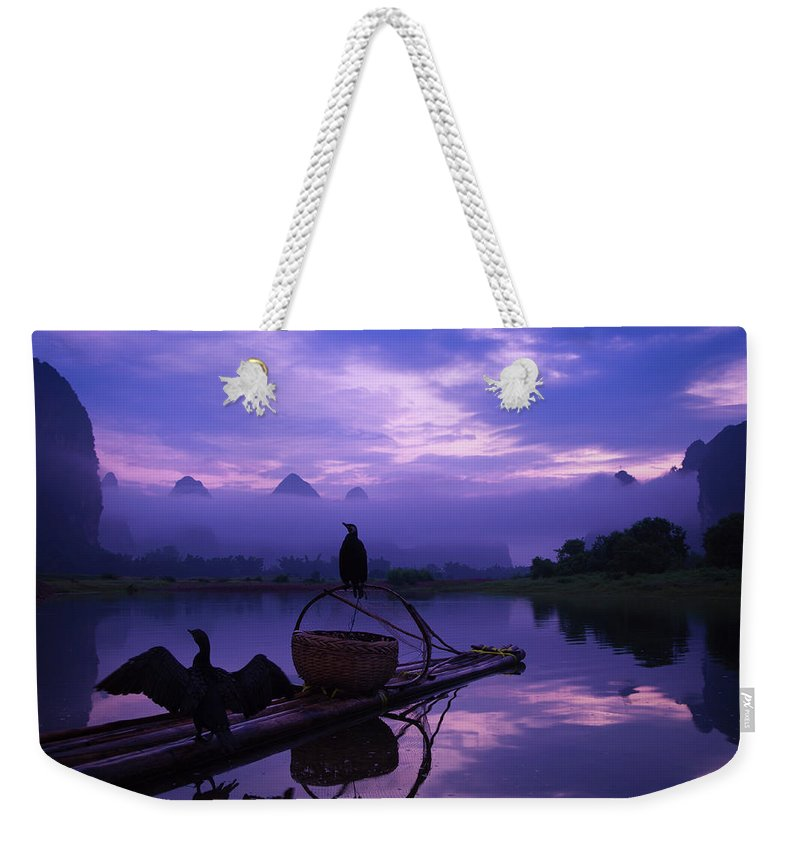 Chinese Culture Weekender Tote Bag featuring the photograph Cormorant On Li River by Coffeeyu