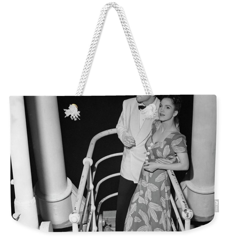 Heterosexual Couple Weekender Tote Bag featuring the photograph Couple In Evening Wear by George Marks
