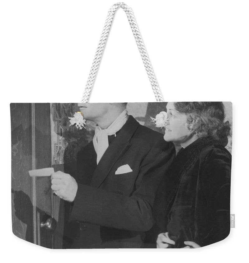 Young Men Weekender Tote Bag featuring the photograph Couple In Formal Wear Showing Pass To by Fpg