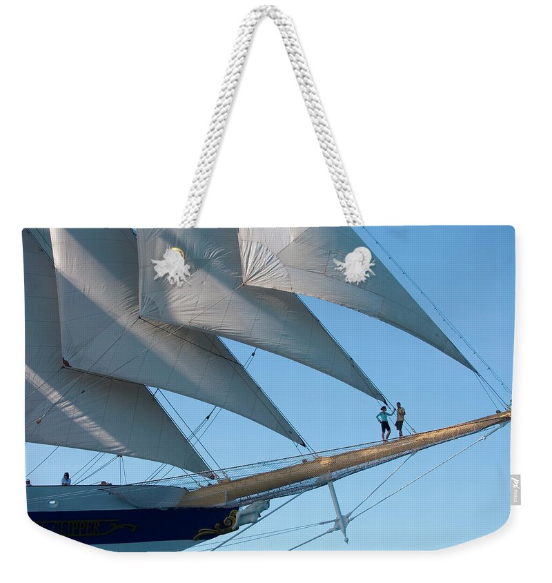 Heterosexual Couple Weekender Tote Bag featuring the photograph Couple On Bowsprit Of Sailing Ship by Holger Leue