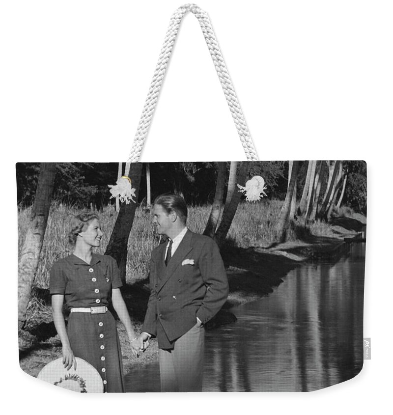 Heterosexual Couple Weekender Tote Bag featuring the photograph Couple Outdoors by George Marks