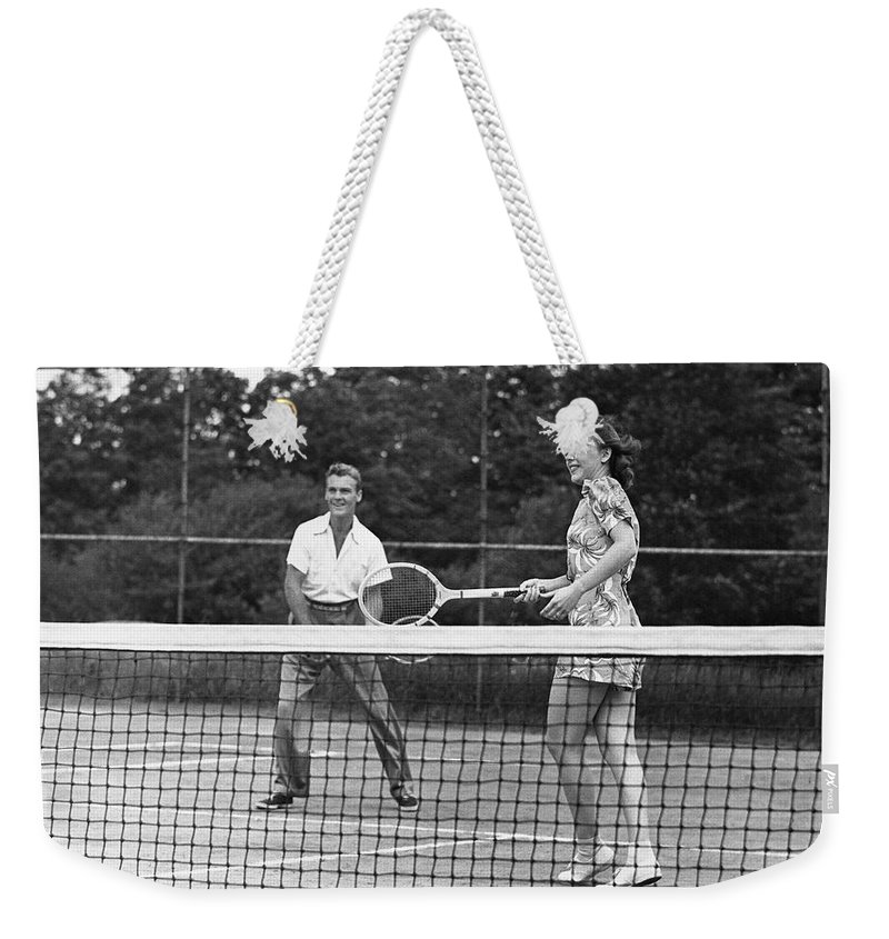 Heterosexual Couple Weekender Tote Bag featuring the photograph Couple Playing Tennis by George Marks