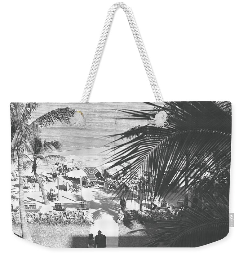 Heterosexual Couple Weekender Tote Bag featuring the photograph Couple Walking In Path Towards Beach by George Marks