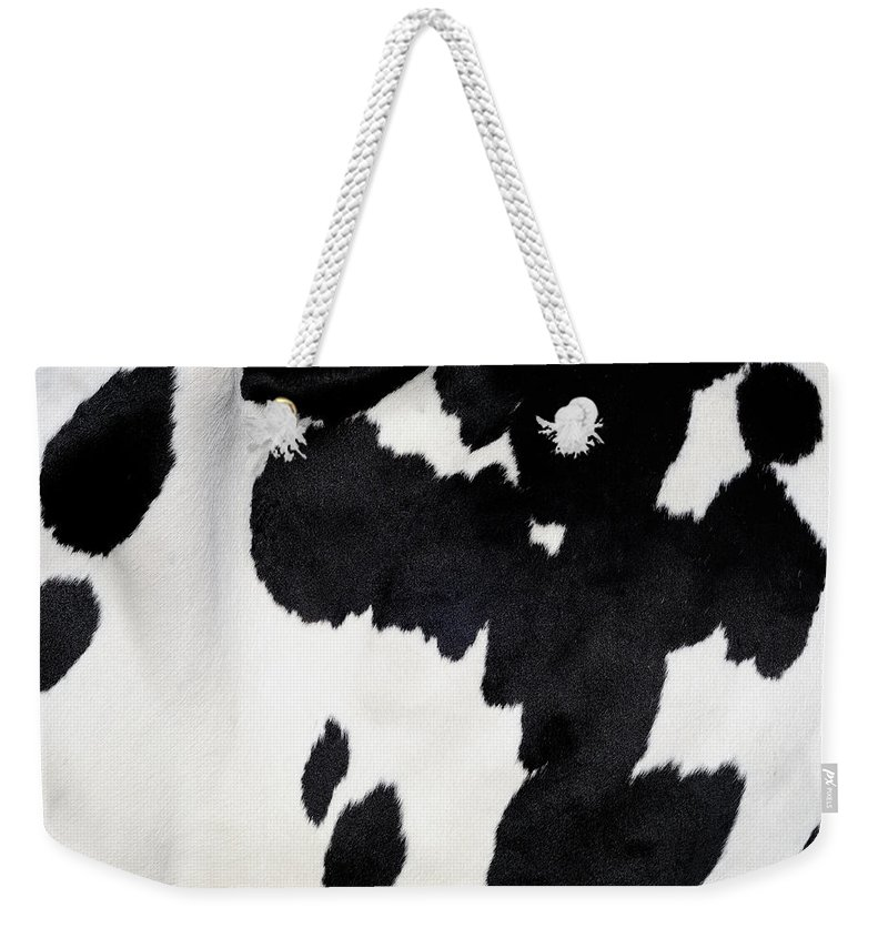 Animal Skin Weekender Tote Bag featuring the photograph Cow Background by Nikitje