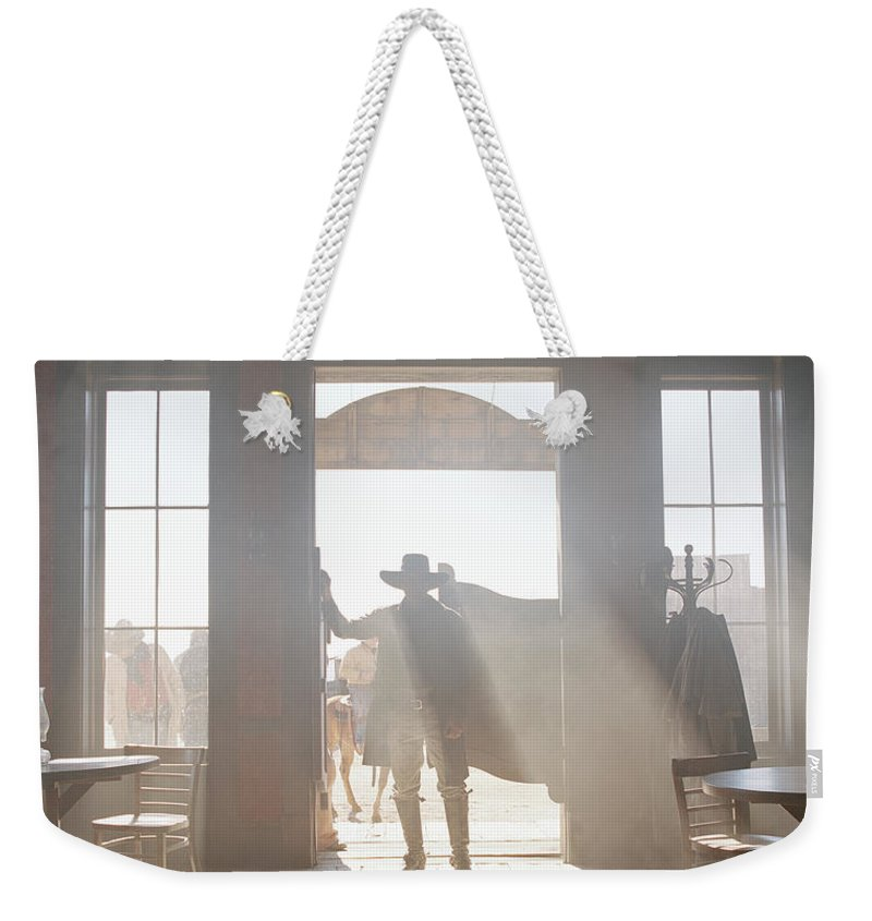 Shadow Weekender Tote Bag featuring the photograph Cowboy At Saloon by Matthias Clamer