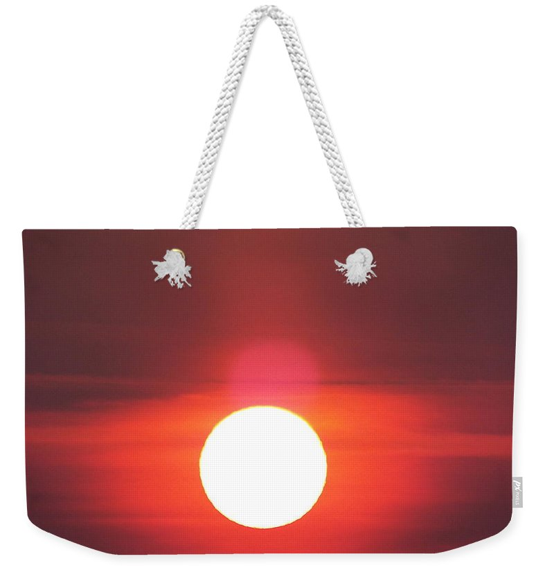 Weekender Tote Bag featuring the photograph Crimson Sun by James Harris