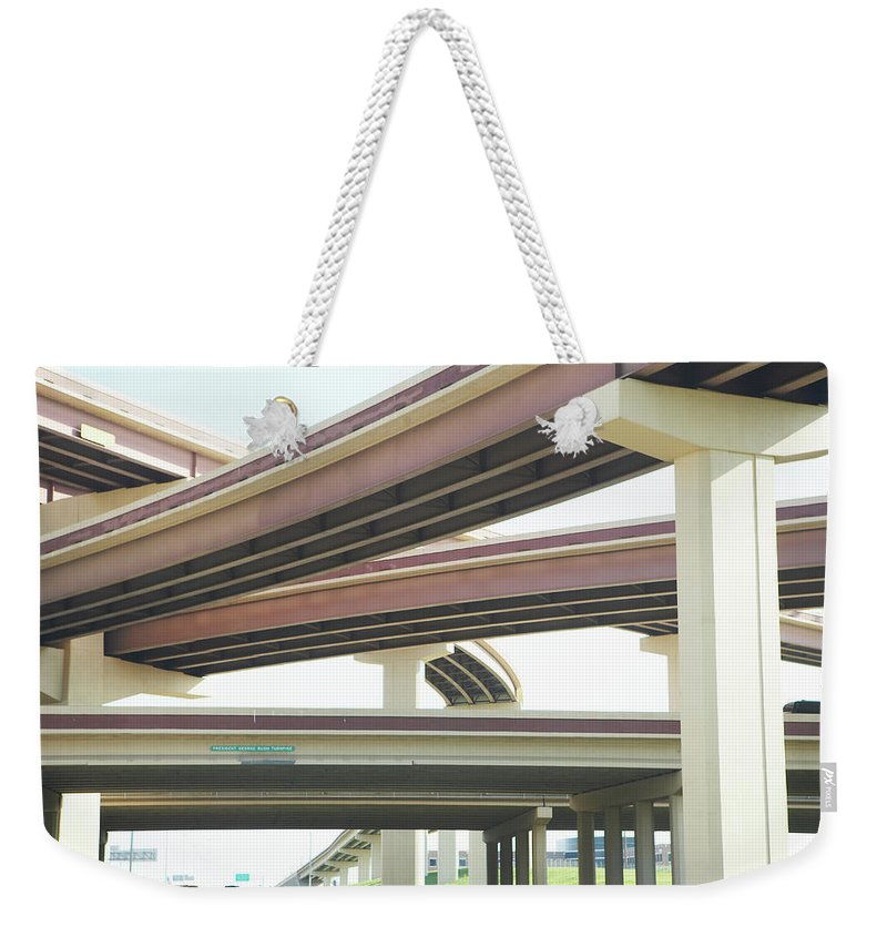 Crisscross Weekender Tote Bag featuring the photograph Crisscrossing Freeway Overpasses by Siri Stafford