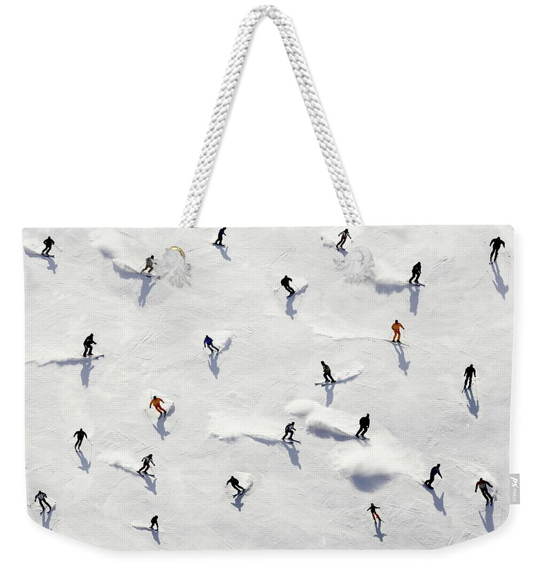 Skiing Weekender Tote Bag featuring the photograph Crowded Holiday by Mistikas