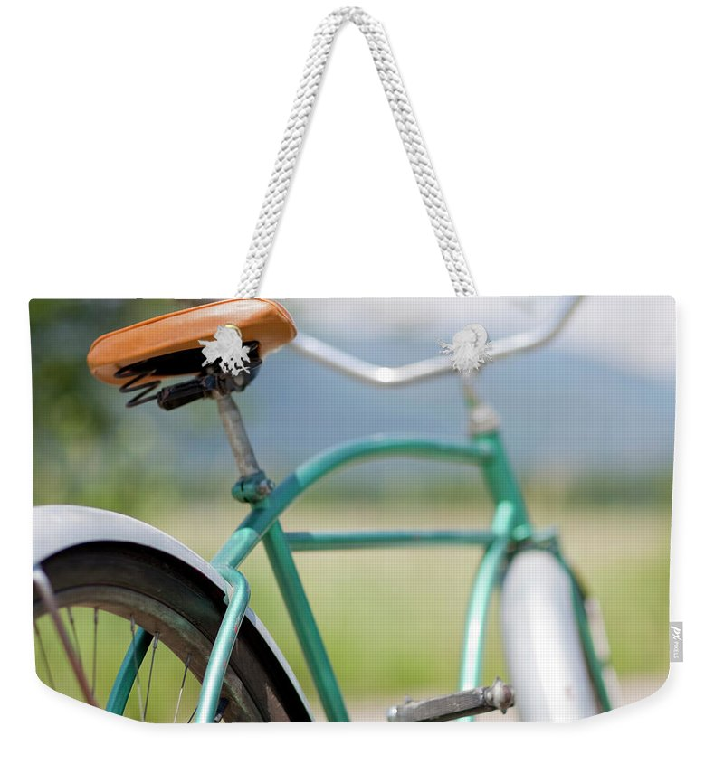 Tranquility Weekender Tote Bag featuring the photograph Cruiser Bicycle by Rocksunderwater